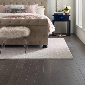 custom area rug in bedroom | Broadway Carpets, Inc