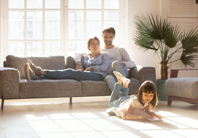 Family enjyng in living room | Broadway Carpets, Inc